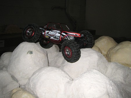 A Losi Mini Rock Crawler on the indoor course
